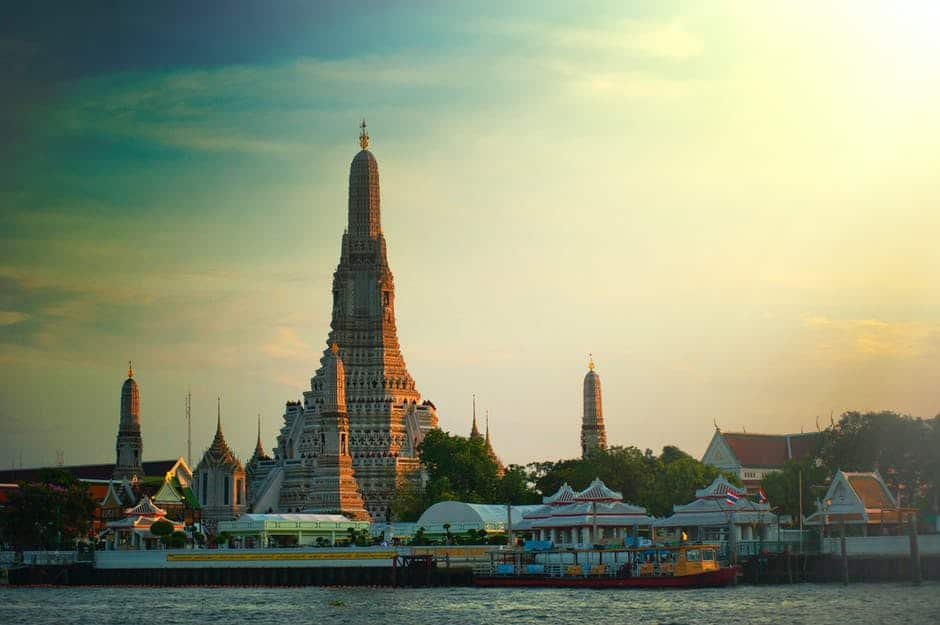A large body of water with Wat Arun in the background