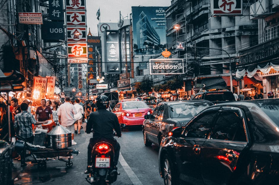 A crowded city street filled with lots of traffic